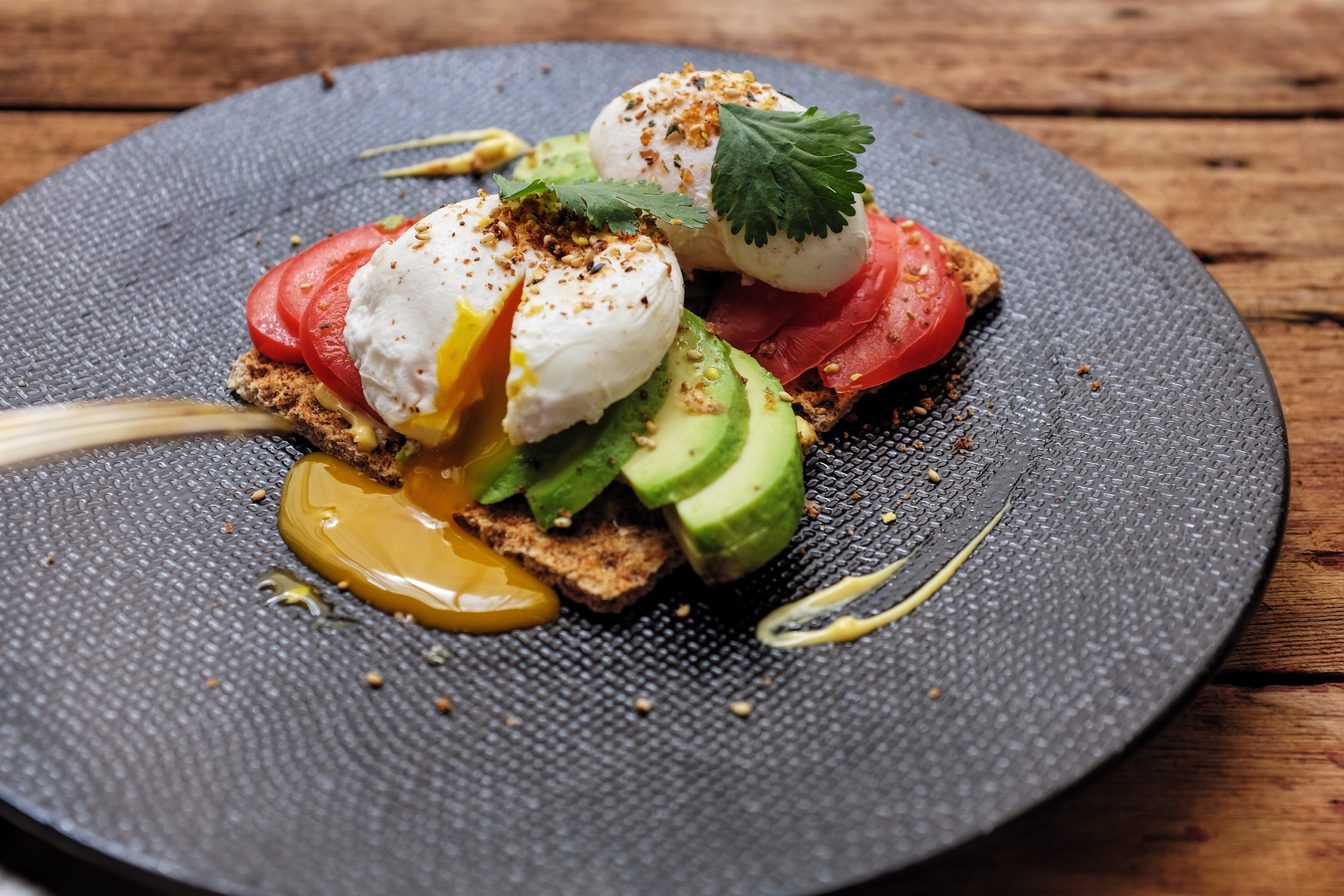 Tasty Eggs with avocado and tomatoes